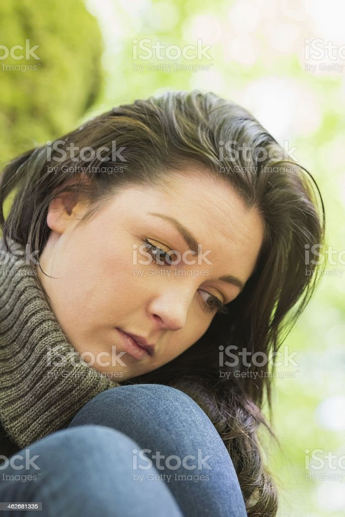 Worried woman reflecting in green forest royalty-free stock photo
