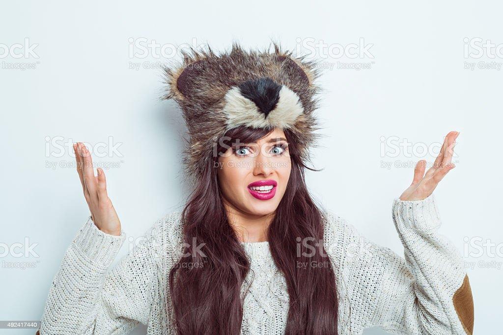 Worried woman wearing fur cap stock photo