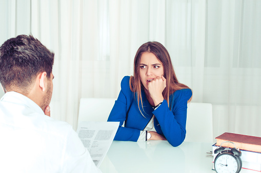 Worried Woman With Boss Reading Report Stock Photo - Download Image Now