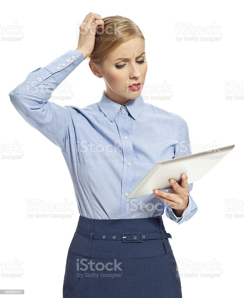 Worried woman with digital tablet Portrait of worried young accountant or secretary looking at a digital tablet. Studio shot, white background. 20-29 Years Stock Photo