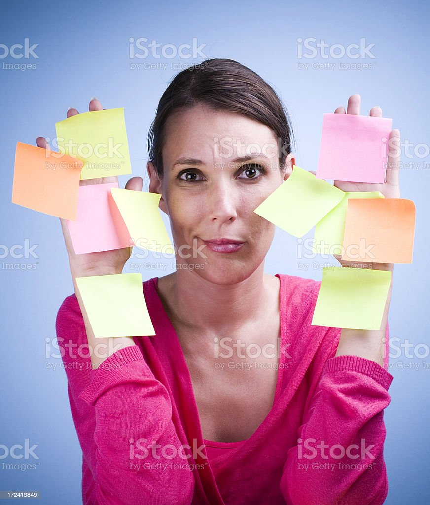 Worried woman with many notes on hands royalty-free stock photo