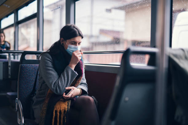 Worried Woman With Protective Face Mask In Bus Transport.