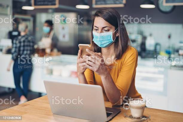 Worried woman with protective mask cell phone and laptop picture id1213482806?b=1&k=6&m=1213482806&s=612x612&h=dzpupjm8 1lupbf 5rhpk6bvss0hubrvynjs qkzz1e=