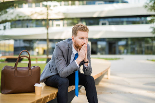 Worried young businessman contemplating and anticipating. stock photo