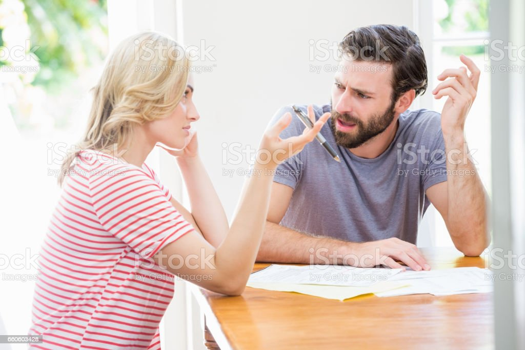 Worried young couple discussing on bills royalty-free stock photo
