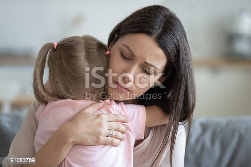 istock Worried young foster mother comforting embracing adopted child daughter 1191083789
