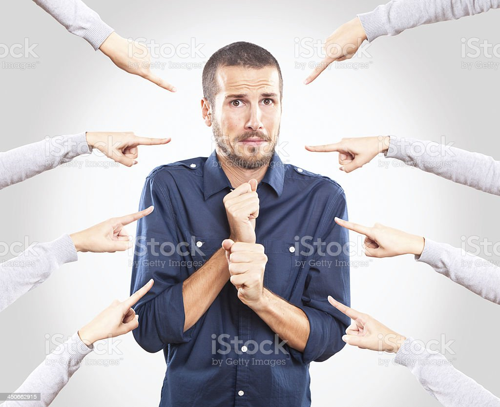 Worried young man being accused stock photo