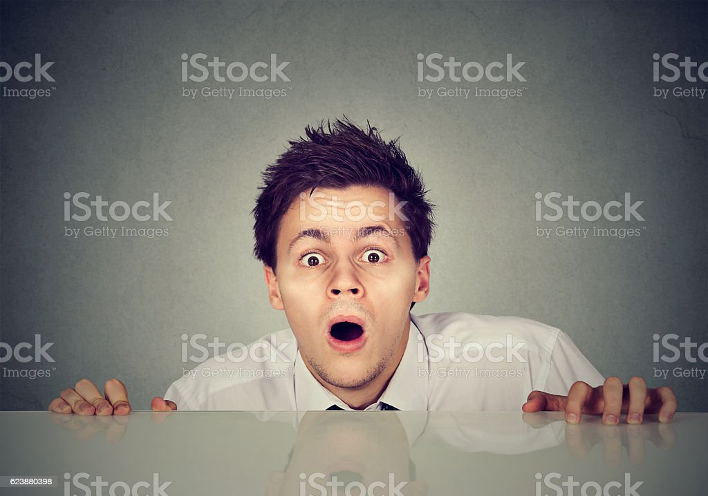 worried young man looks at camera stock photo