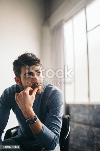 istock Worried young man 618973604