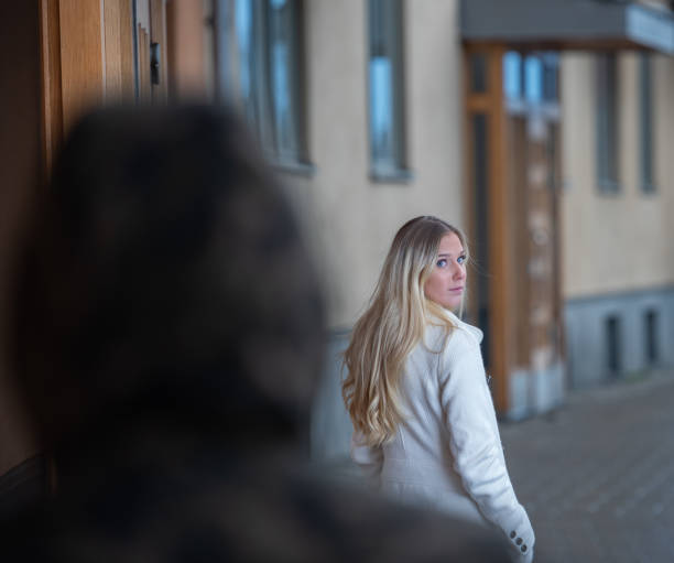 worried young woman being followed - stalking stock photos and pictures