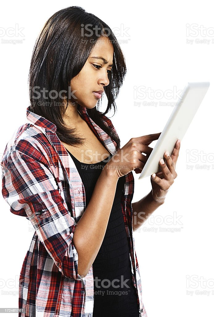 Worried young woman looking down at digital tablet touch screen royalty-free stock photo