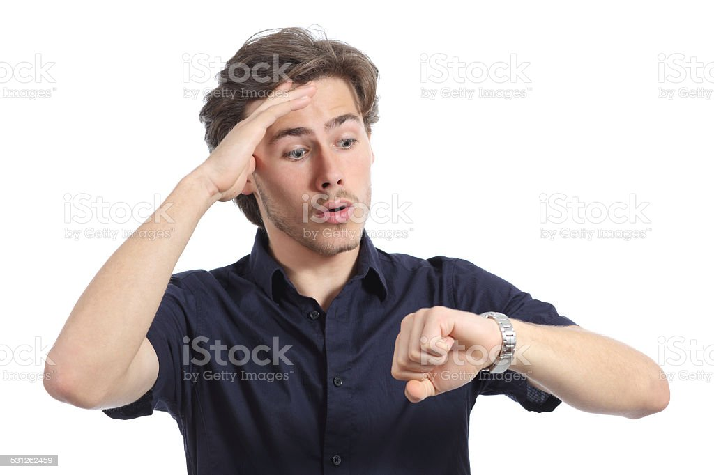 Worrier man running out of time looking his watch stock photo