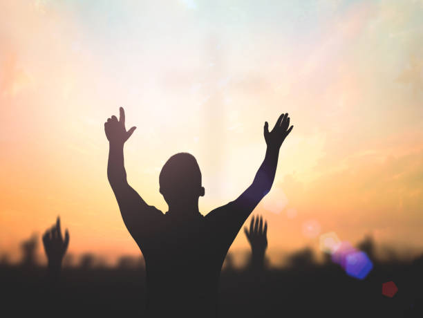 Worship and praise concept stock photo
