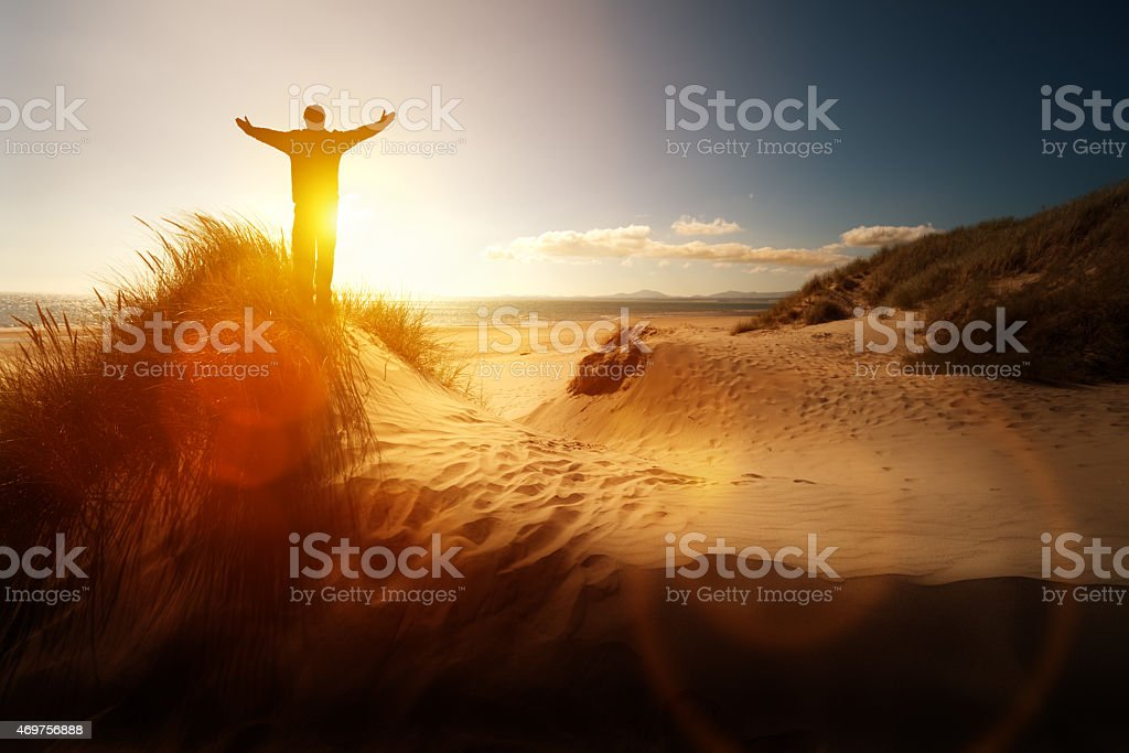 Worship and praise on a beach stock photo