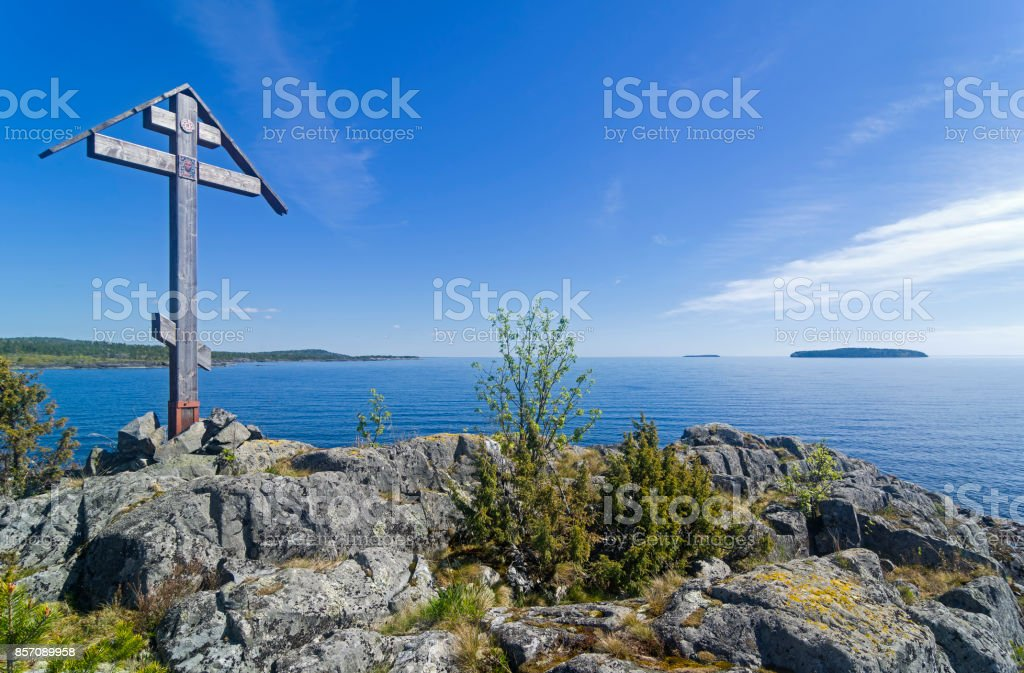 Worship cross on a rock on the shore of the Ladoga Lake stock photo