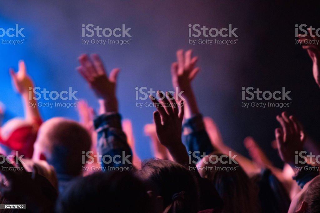 Worship hands raised stock photo