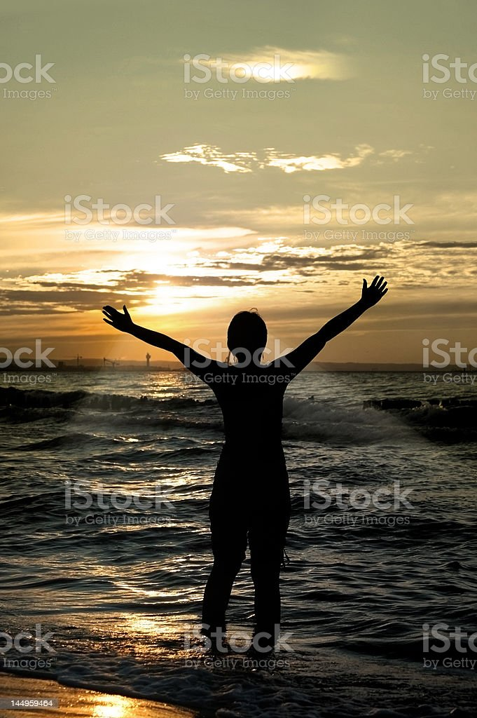 worshipper against incredible summer sunset stock photo