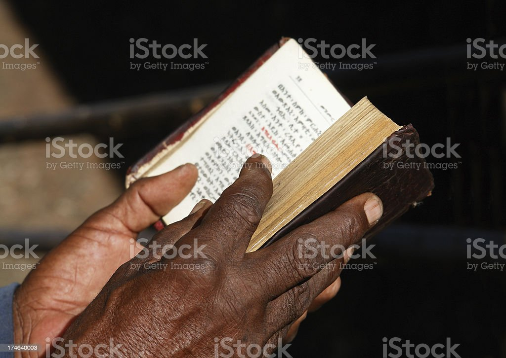 Worshipper Reading Holy Bible in Lalibela Ethiopia stock photo