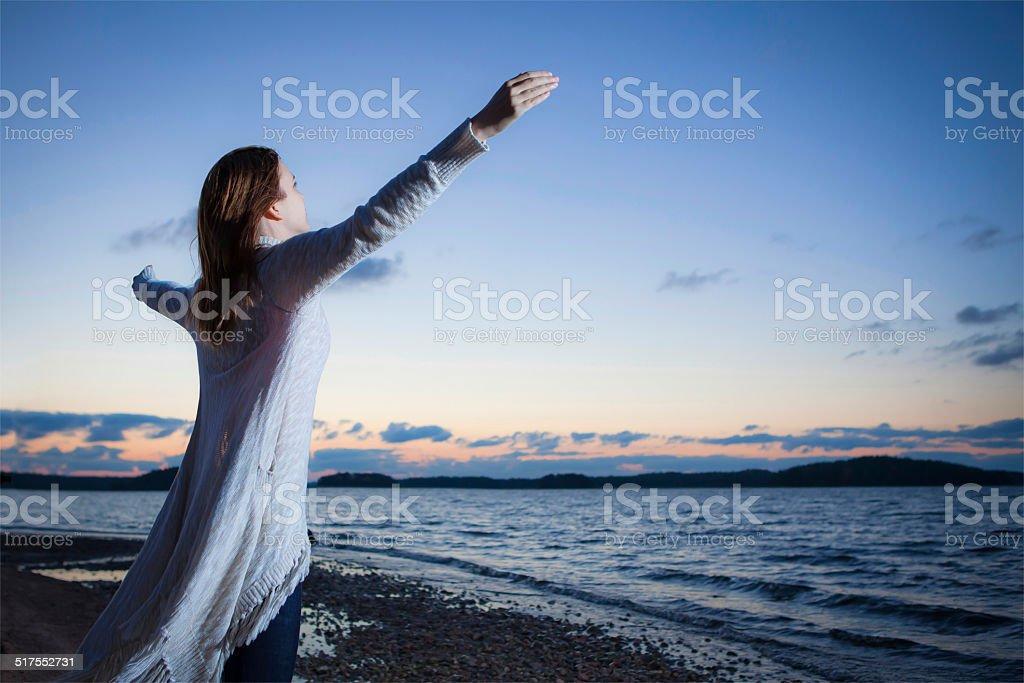 Worshipping girl stock photo