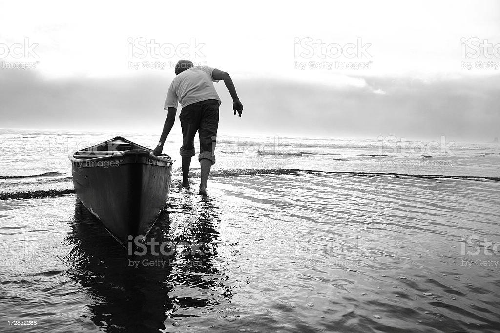 man and canoe on the ocean