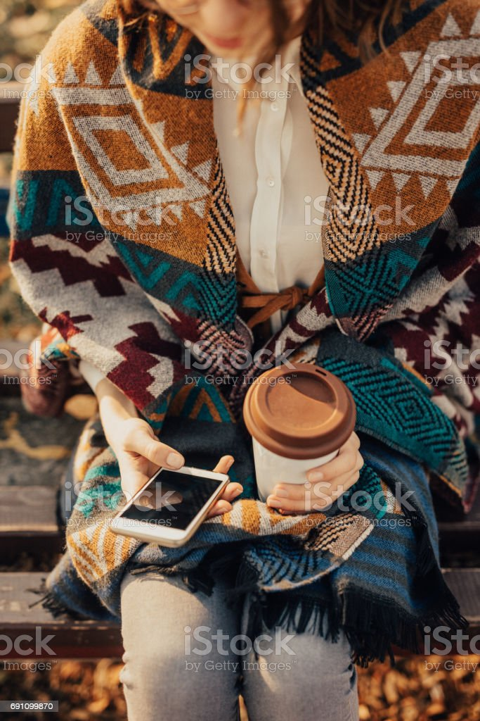 Would you like to join me for a cup of coffee in the park? stock photo