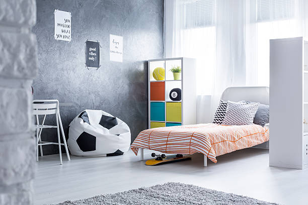 would you like to sit on a ball? - schlafzimmer teenager stock-fotos und bilder