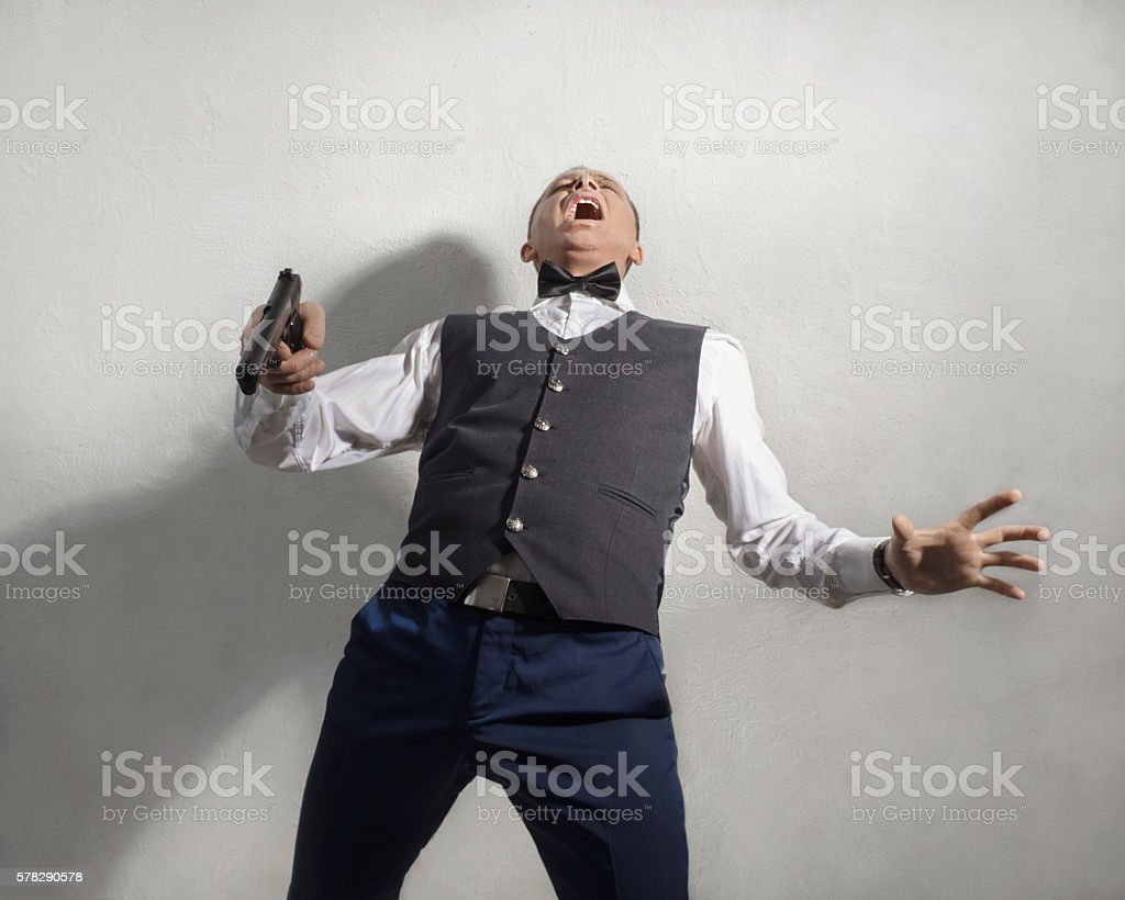 Wounded agent with a gun stock photo