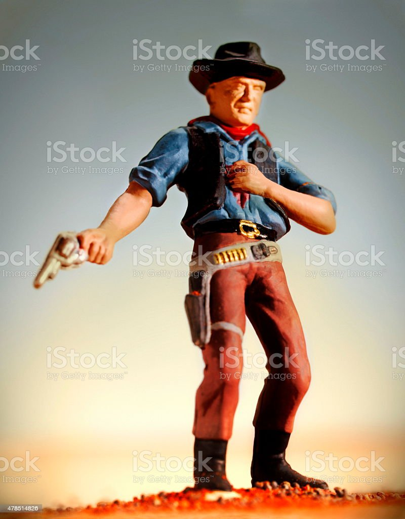 Wounded Cowboy Holding Gun stock photo