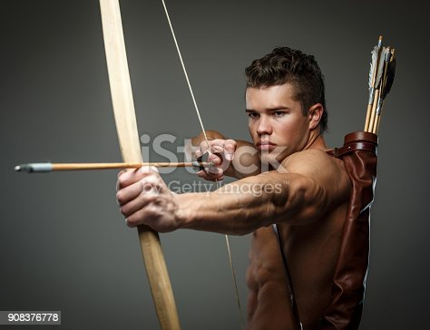istock Wounded gladiator with bow 908376778