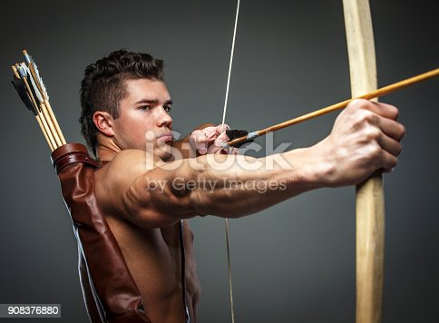 istock Wounded gladiator with bow 908376880