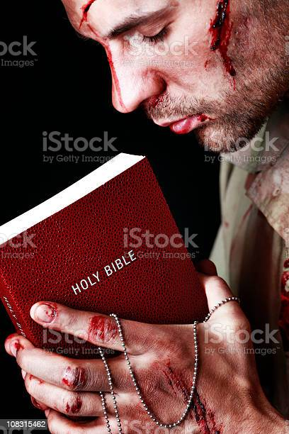 Wounded Soldier Holding Bible Stock Photo - Download Image Now