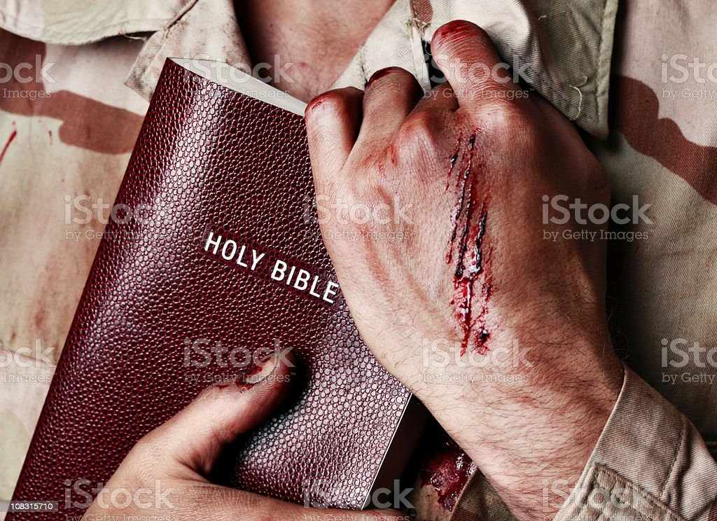 Wounded Soldier Holding Bible royalty-free stock photo