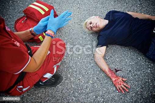 508966965 istock photo Wounded woman with paramedic 508966963