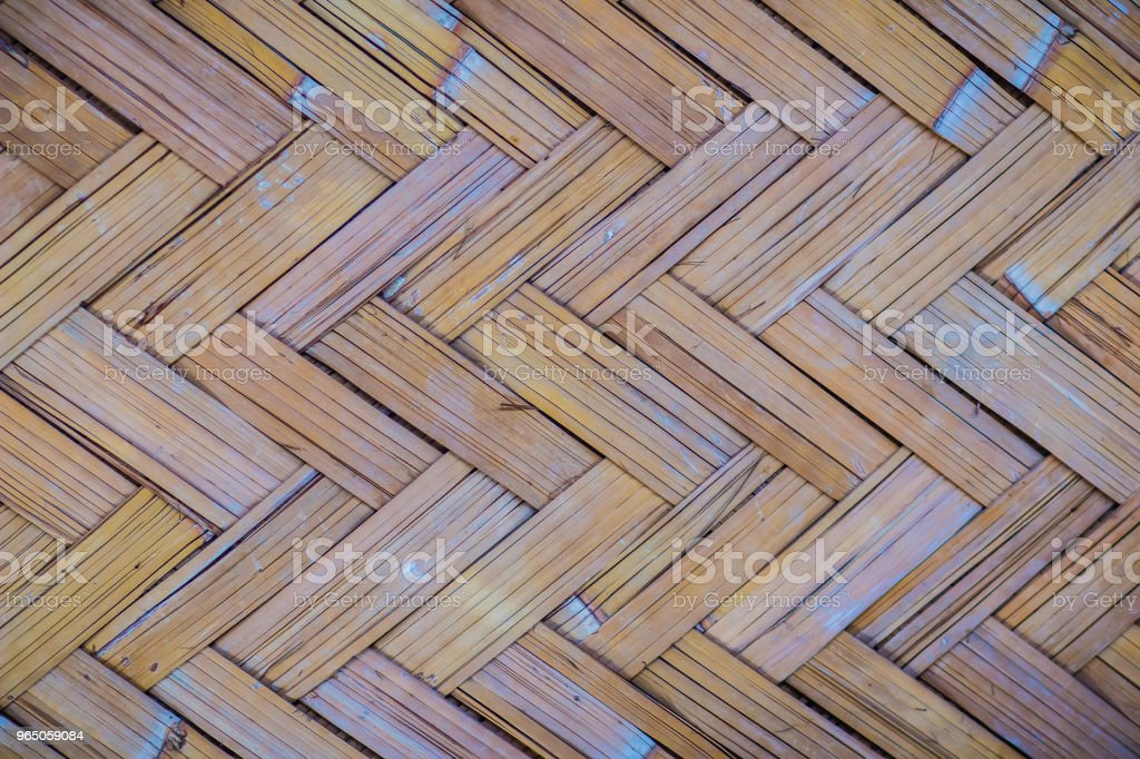 Woven bamboo pattern for background. Handicraft bamboo wood weave texture. Old bamboo weaving pattern texture for background and design art work. zbiór zdjęć royalty-free