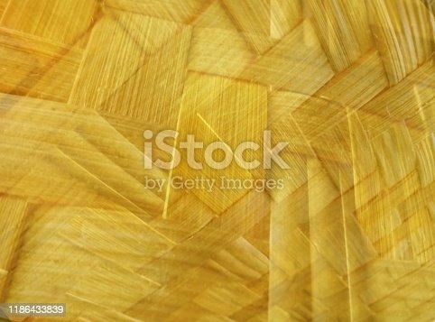 Yellow background abstract thin irregular woven bamboo