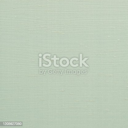859441184 istock photo Woven cotton linen fabric textile textured backdrop in pastel light yellow spring green color 1205627050