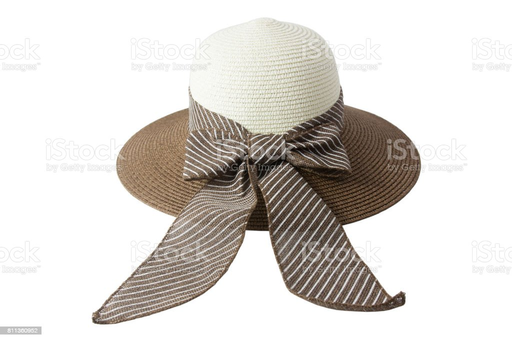 Woven hat with brown, beige, decorated with a pink bow tie. stock photo