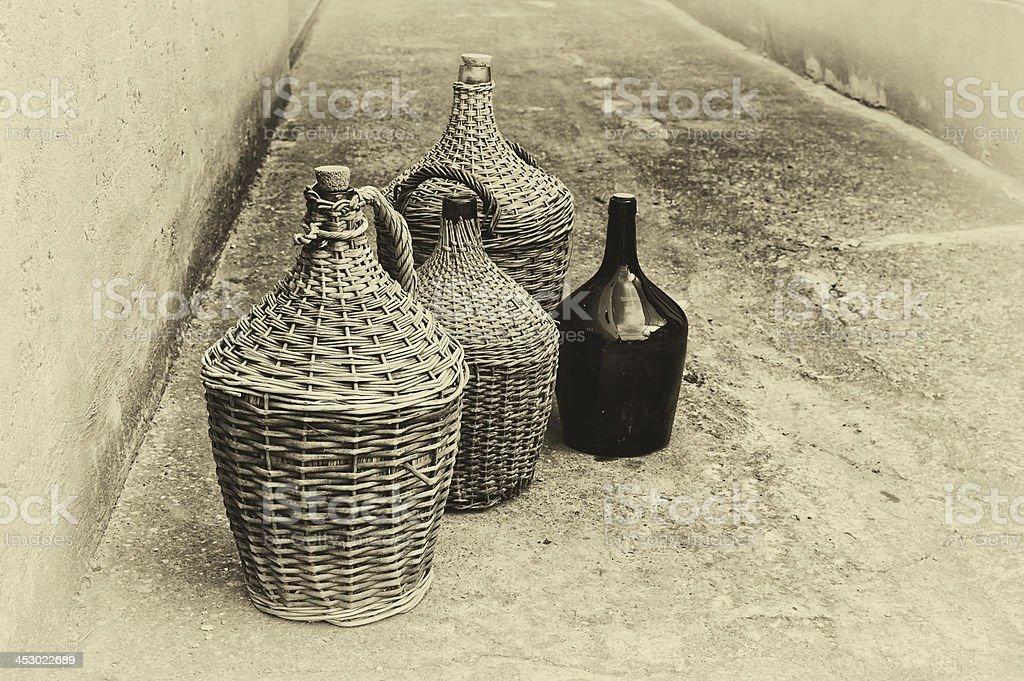 Woven wicker wine bottles. royalty-free stock photo