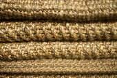 Stacked Woven Wool Rugs Background