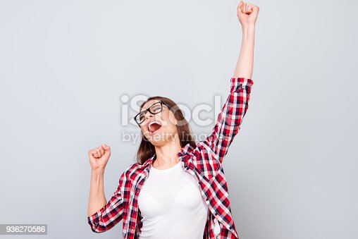 istock Wow! Happiness, dream, fun, joy concept. Very excited happy girl is jumping up, wearing casual clothes, on pure light blue background 936270586