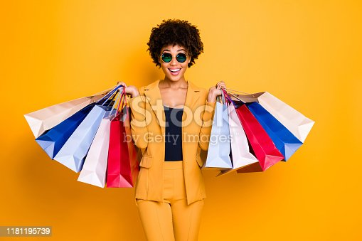 istock Wow omg 50 off. Portrait of surprised shocked brunette hair dark skin girl travel trip see sales black friday go shopping feel crazy wear style outfit trousers isolated bright color background 1181195739