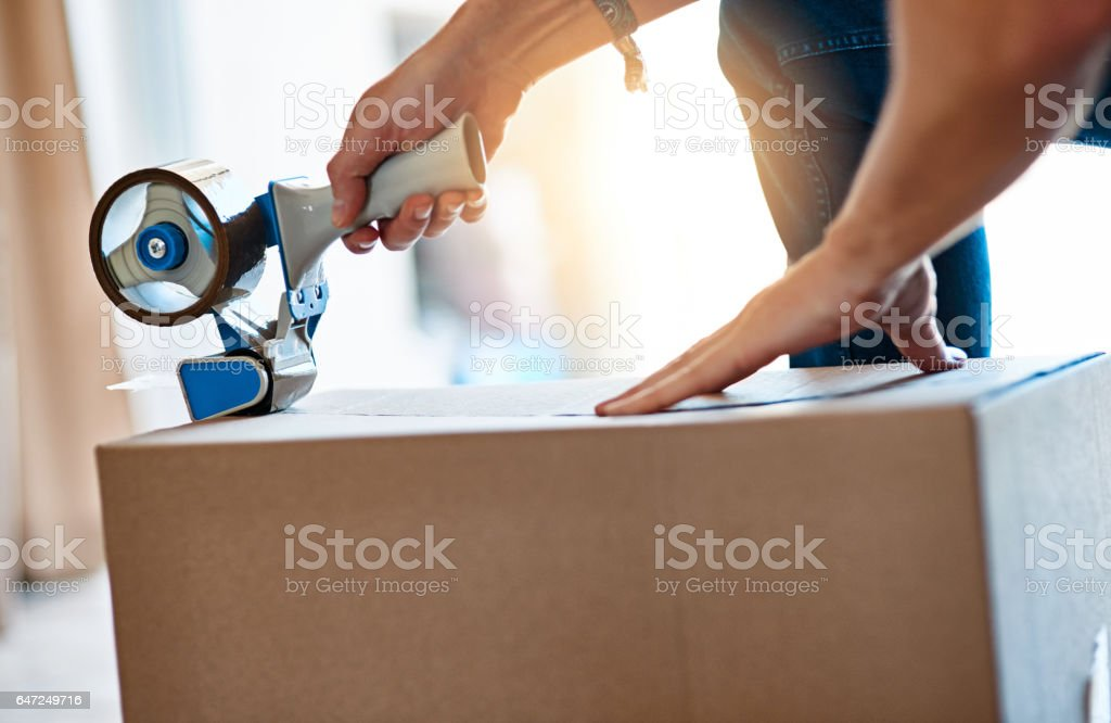Wrap it, pack it, tape it stock photo