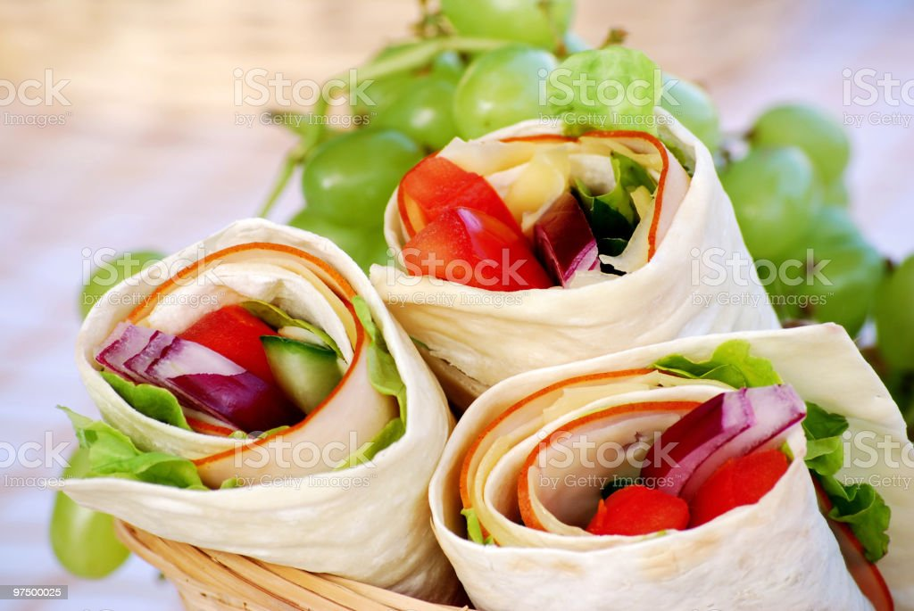 Wrap sandwiches in a picnic basket stock photo