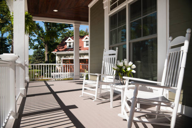 Wrap-around porch in summer. stock photo