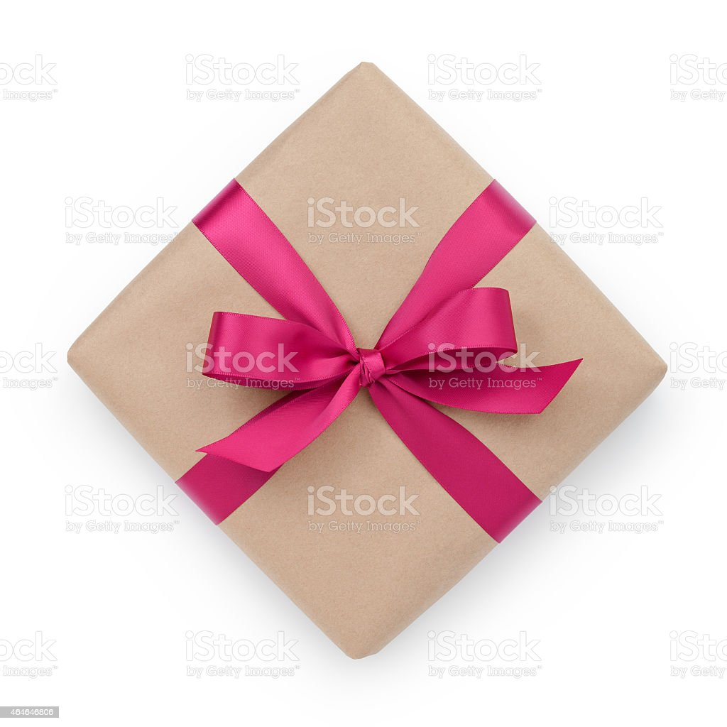 wrapped brown present box with purple ribbon bow stock photo