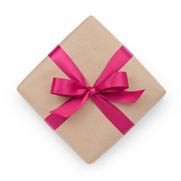 wrapped brown present box with purple ribbon bow wrapped brown present box with purple ribbon bow, isolated on white birthday present stock pictures, royalty-free photos & images