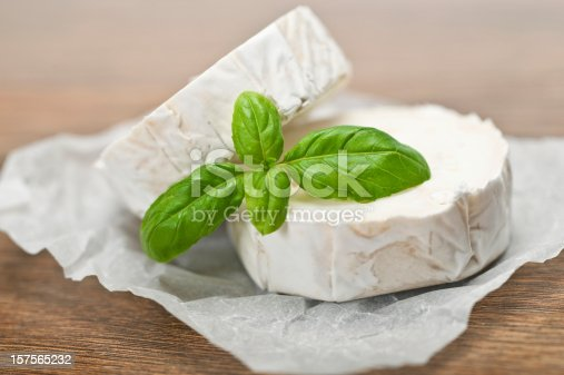 Goats Cheese on wooden background with shallow depth of field