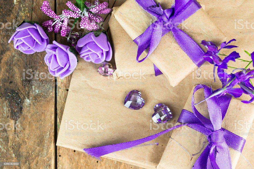 Wrapped gift boxes with presents and decorative flowers royalty-free stock photo