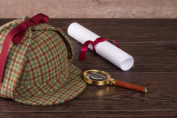 Wrapped paper sheets and magnifying glass Wrapped paper sheets and magnifying glass on Old Wooden table. deerstalker hat stock pictures, royalty-free photos & images