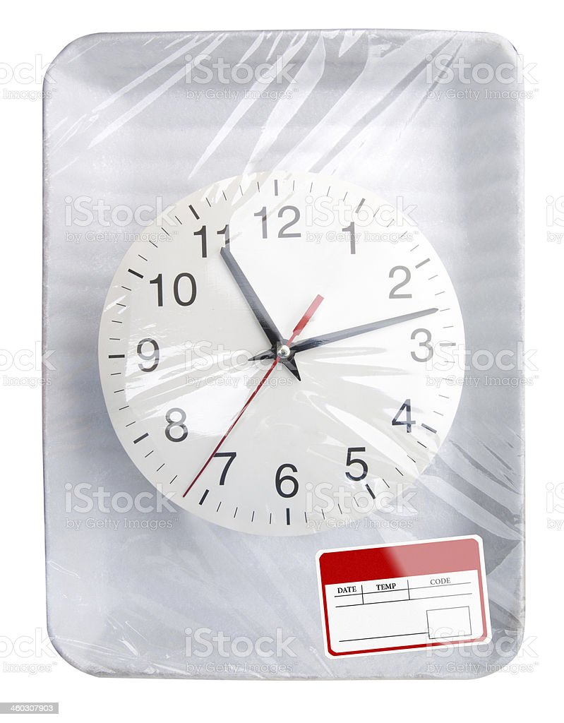 Wrapped plastic food container with clock stock photo